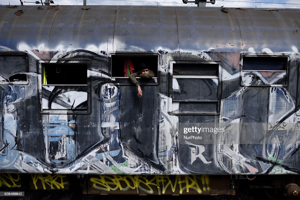 A Syrian refugee is looking through the window of a train cabin, where he sleeps, at Idomeni refugee camp on May 5'th, 2016. Thousands of migrants are still located in the makeshift refugee camp, located at the Greek Macedonian border, waiting for the border to re-open.