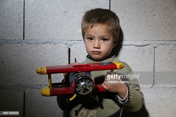 Syrian refugee kid fled from his home due to civil war is seen at a house in Reyhanli district of Hatay on November 21 2015 Syrian refugee families...
