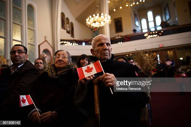 TORONTO ON DECEMBER 11 Syrian refugee Kivork Karajalian attends a mass at the Armenian Community Centre of Toronto after arriving in Canada last night