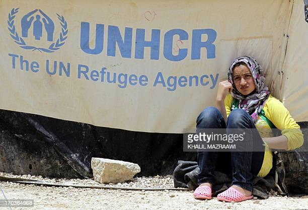 Syrian refugee leans against a tent in the northern Jordanian Zaatari refugee camp now home to 160000 Syrians equal in size to what would be Jordan's...