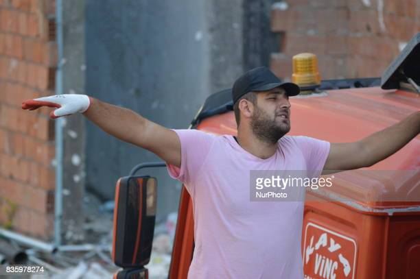 A Syrian refugee man can be seen working at a construction site in the Anayurt neighbourhood of Ankara Turkey on August 20 2017