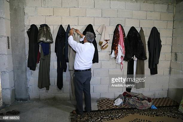 Syrian refugee man fled from his home due to civil war hangs his clothes at a house in Reyhanli district of Hatay on November 21 2015 Syrian refugee...