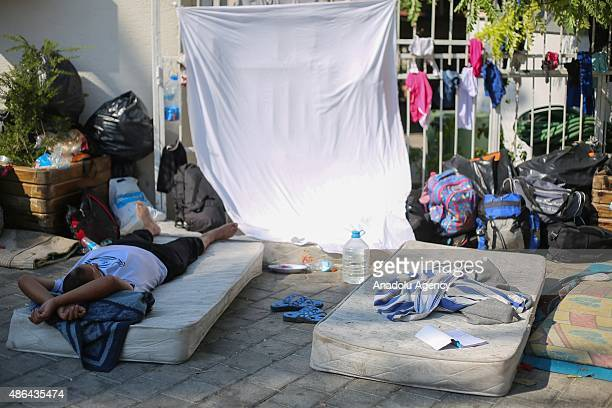 Syrian refugee man who escaped from Syria sleeps on a bedding at a mosque's park in Izmir Turkey on September 3 2015 Syrians who came to Turkey's...