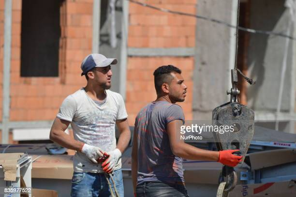 Syrian refugee men can be seen working at a construction site in the Anayurt neighbourhood of Ankara Turkey on August 20 2017