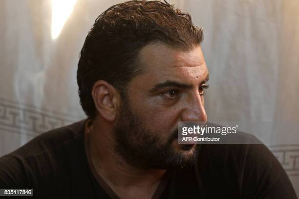 Syrian refugee Mohamed Ghazal sits in a home in the northern Jordanian city of Irbid where his family is being housed under a programme working in...
