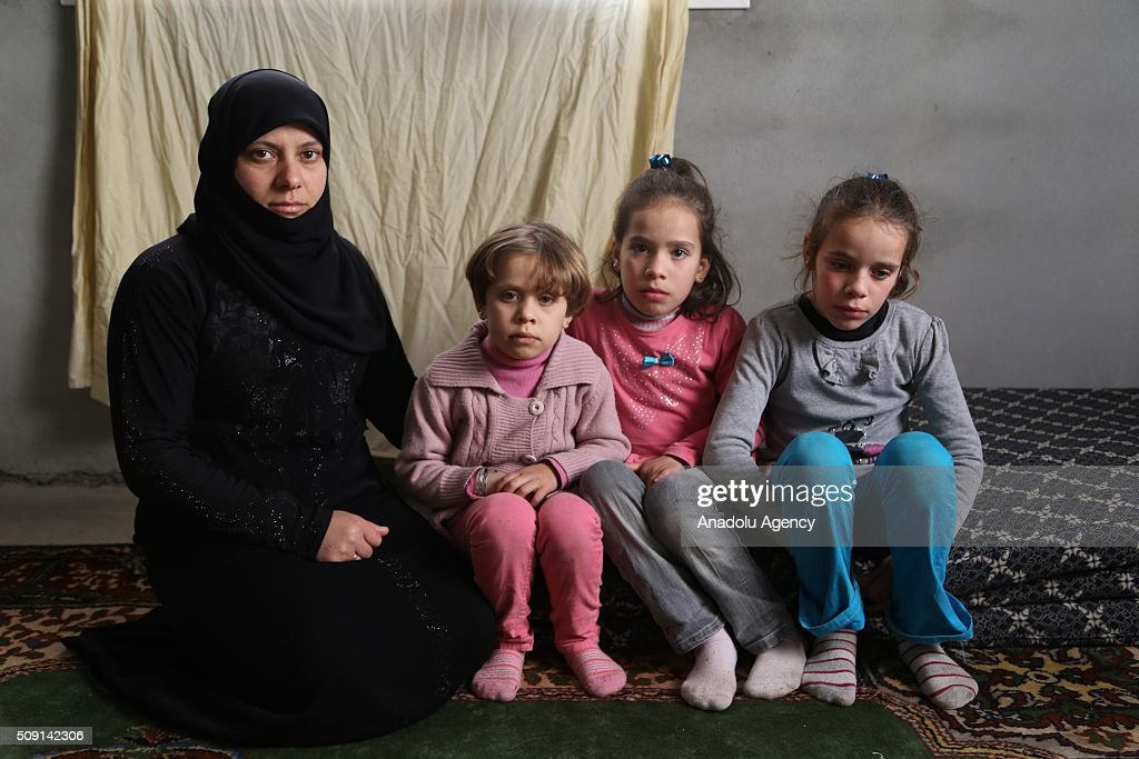 Syrian refugee Necat Said (L), fled from Syria due to ongoing civil-war, poses with her nieces at a house in Turkey's Syrian border city Hatay's Reyhanli District on February 08, 2016. Necat Said had lost her elder brother and brother's wife due to a Assad Regime's barrel bomb attacks. Turkey spent US$ 8 Billion and hosts approximately 2 million refugees.
