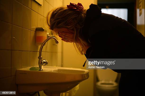 Syrian refugee Reem Haskour washes her face after awaking at the community center of the church congregation Kreuzkirch October 7 2015 in Hamburg...
