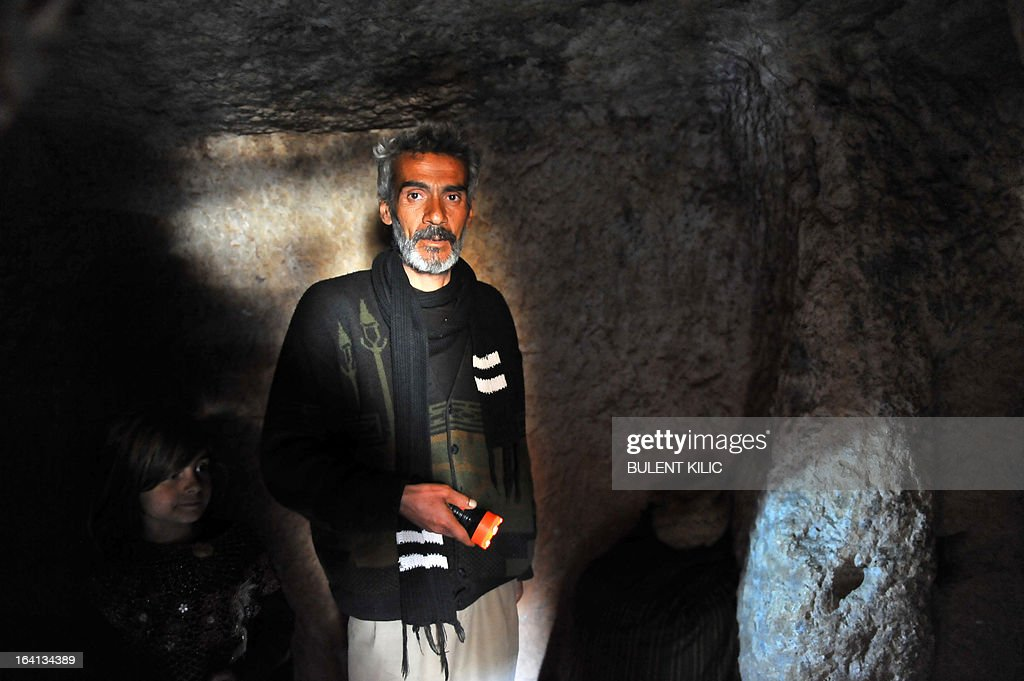 A Syrian refugee shows his make shift home in the catacombs of the ruins of the ancient Roman city of of Serjilla, in the northwestern province of Idlib, on March 20, 2013. The number of Syrian refugees, already past the million mark, could double or triple by the end of the year if no solution is found to the conflict, the UN High Commissioner for Refugees said earlier this month.