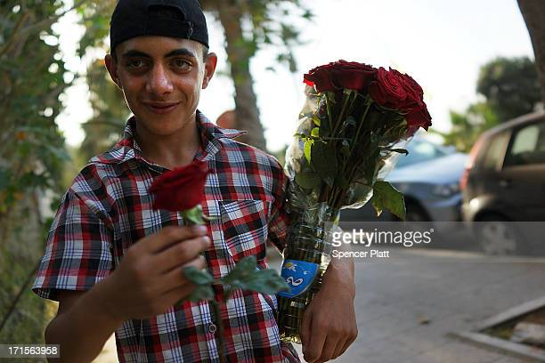 Syrian refugee teen sells flowers along the corniche on June 26 2013 in Beirut Lebanon Cosmopolitan Beirut which has for centuries been a melting pot...