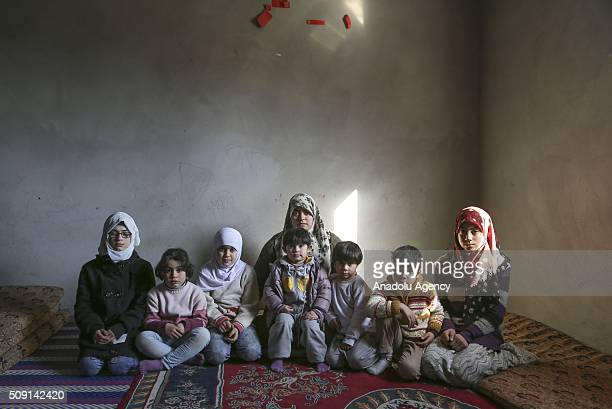 Syrian refugee widow mother Emira Said fled from Syria due to ongoing civilwar poses with her 7 children at a house in Turkey's Syrian border city...