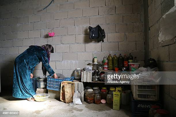 Syrian refugee woman fled from her home due to civil war is seen near provisions at a house in Reyhanli district of Hatay on November 21 2015 Syrian...