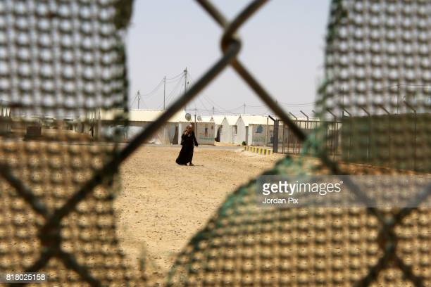 Syrian refugee woman is seen at the innovation center that is run by Relief International and the unicef under the hot sun near his makeshift home at...
