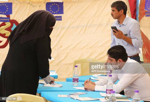 A Syrian refugee woman registers her name at the Zaatari office for employment on October 4 2017 in the refugee camp 80 kilometres north of the...