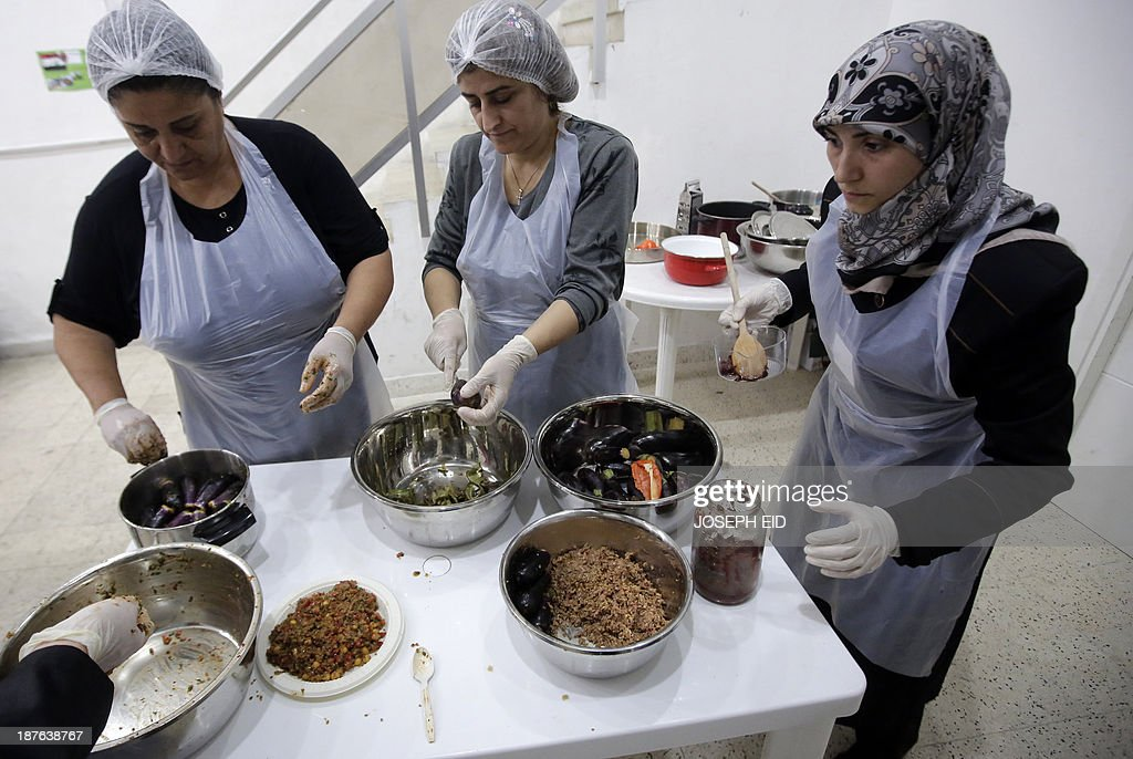 Syrian refugee women prepare their regional dishes at Caritas Lebanon Immigrants Centre in the Lebanese capital, Beirut, on November 6, 2013. For two months these women have been participating in a food skills workshop dreamed up by a Lebanese restaurant and financed by the UN's refugee agency UNHCR with help from the Lebanese branch of the charity Caritas, where they are learning to translate knowledge of their local dishes into a marketable skill.