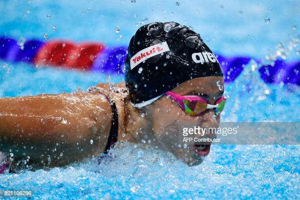 Syrian refugee Yusra Mardini competes in a women's 100m butterfly heat during the swimming competition at the 2017 FINA World Championships in...