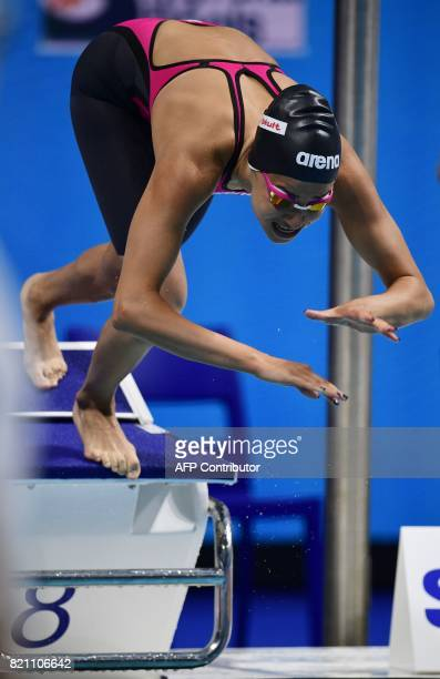 Syrian refugee Yusra Mardini dives at the start of a women's 100m butterfly heat during the swimming competition at the 2017 FINA World Championships...
