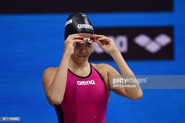 Syrian refugee Yusra Mardini reacts before competing in women's 100m butterfly heat during the swimming competition at the 2017 FINA World...