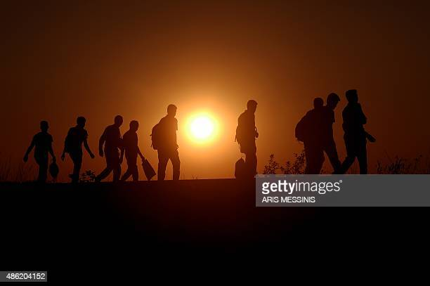 Syrian refugees and migrants along a railway line as they try to cross from Serbia into Hungary near Horgos on September 1 2015 European Union...