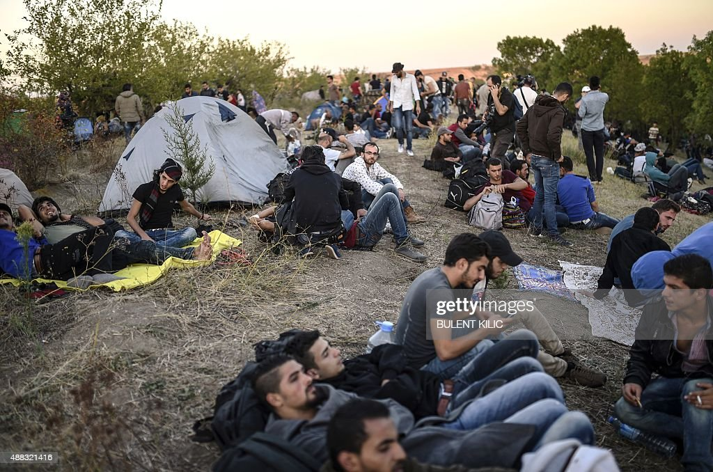 Syrian refugees and migrants gather near the highway on September 15, 2015, on their way to the border between Turkey and Bulgaria in the northwestern Turkish city of Edirne. Over half a million migrants have crossed the European Union's border so far this year, up from 280,000 in 2014, the bloc's Frontex border agency said on September 15, 2015 -- but warned some people may have been counted twice.