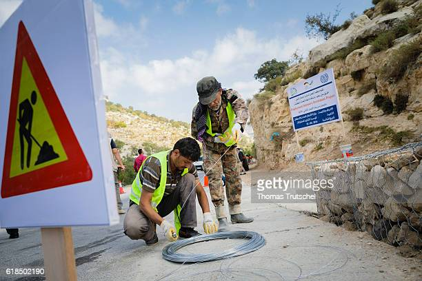 Syrian refugees are employed as workers at a road construction site within the framework of the project 'Construction and repair of roads and sewers'...