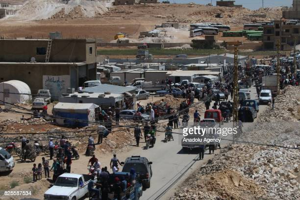 Syrian refugees are seen as they leave Lebanon after a ceasefire announced between Hezbollah and Ahrar alSham in Arsal town of Baalbek Lebanon on...