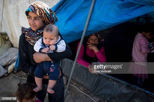 Syrian refugee's are seen at a tent camp on the outskirts of Izmir on April 28 2016 in Izmir Turkey For many Syrian refugees living in Turkey has...