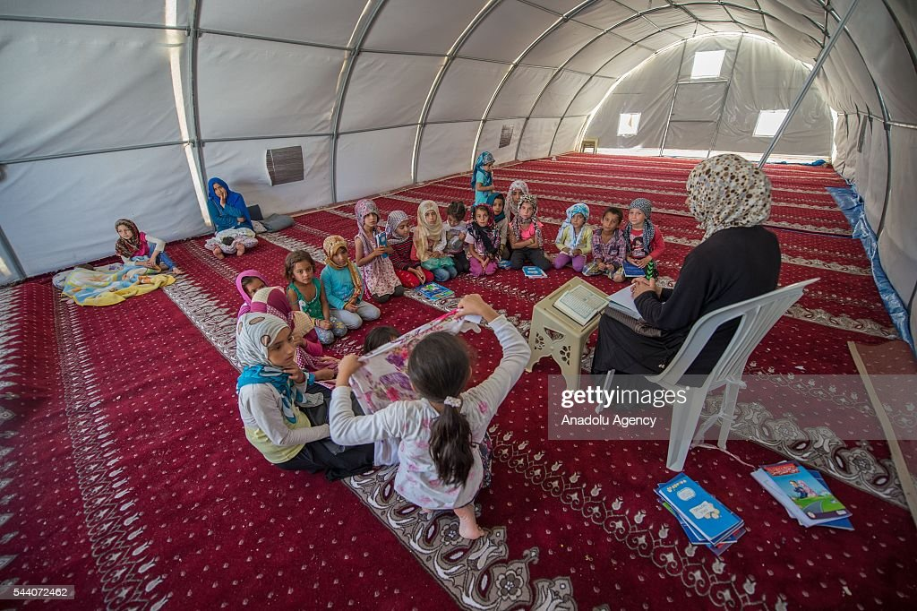 Syrian refugees are seen in Suruc district of Sanliurfa, Turkey on July 01, 2016, as the Syrian people who fled the clashes between Daesh and Kurdish armed groups about two years ego, make preparations for the Eid al-Fitr marks the end of the Muslim holy fasting month of Ramadan by preparing sweets despite the all harsh conditions at the camp away from their home.