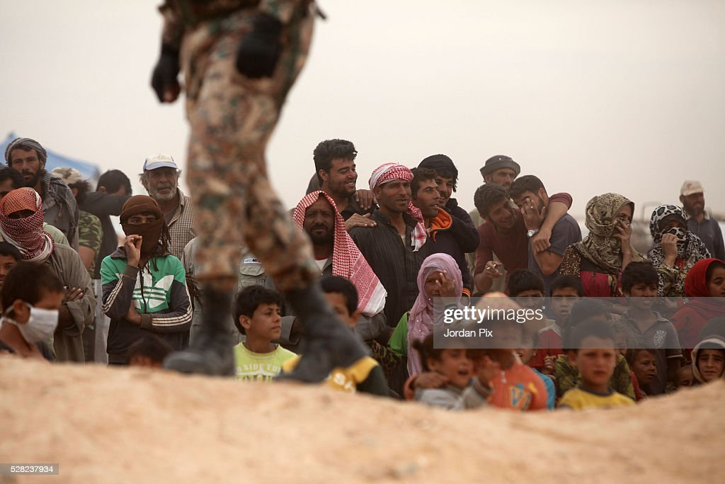 Syrian refugees arrive at the Jordanian military crossing point of Hadalat at the border with Syria after a long walk through the Syrian desert on May 4, 2016 in Hadalat, Jordan. Coming from the cities of Raqaa, Deir Al-Zor and Hama, roughly 300 hundred refugees crossed into Jordan at Hadalat on Wednesday, while over 5000 refugees crossed in the last four days coming from Aleppo.