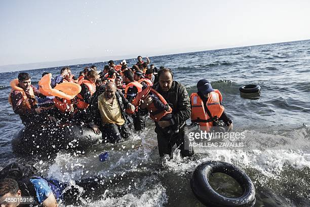 Syrian refugees arrive on the shores of Lesvos island in Greece in an inflatable boat from Turkey on August 23 2015 AFP PHOTO / ACHILLEAS ZAVALLIS