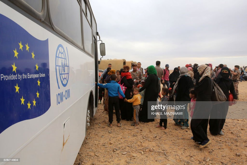 Syrian refugees board a bus before entering the Jordanian side of the Hadalat border crossing, a military zone east of the capital Amman, after arriving from Syria on May 4, 2016. According to the Jordanian Commander of the Border Guards Brigadier Saber Al-Mahayreh, around 5000 Syrians fleeing from recent attacks on the northern Syrian city of Aleppo are trying to cross into Jordan in search of safety and most are exhausted and desperately in need of help and medical treatment. MAZRAAWI