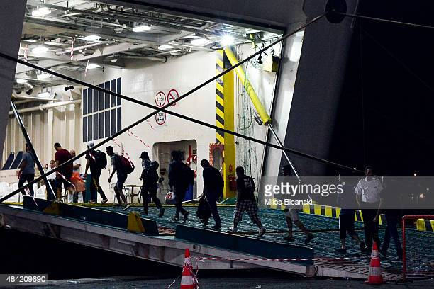 Syrian refugees board the passenger ship 'Eleftherios Venizelos' at Kos's main port on August 16 2015 in Kos Greece The vessel will house more than...