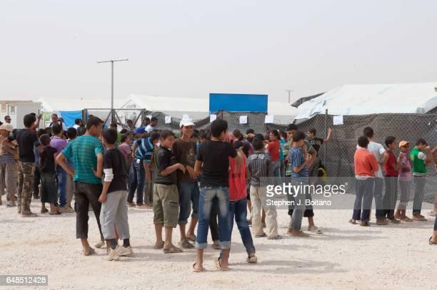 Syrian refugees children line up to register for school in the Zaatari Refugee Camp Jordan