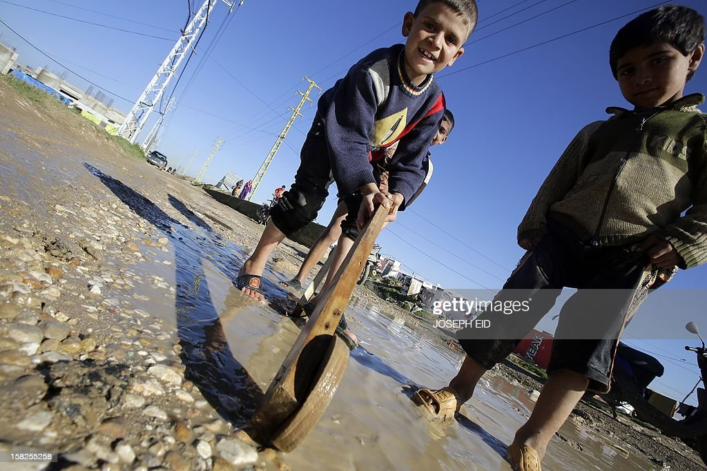 Syrian refugees children play on a muddy road at an agricultural field where they set camp in Saadnayel in the Lebanese Bekaa valley on December 12, 2012. More than half a million Syrian refugees are now registered or are waiting to in other Middle Eastern countries, with about 3,000 new people seeking refugee status and assistance daily, the United Nations refugee agency said on Tuesday. Lebanon now hosts 154,387 registered Syrian refugees who have fled the 20-month-old conflict, Jordan has 142,664, Turkey 136,319, Iraq 65,449 and North Africa 11,740, the UNHCR said.