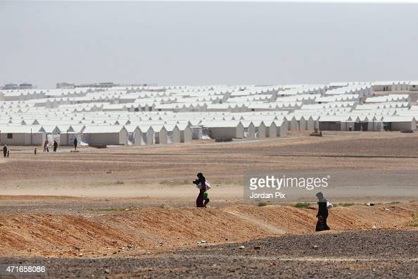 Syrian refugees cross inside AL Azraq camp for Syrian refugees on April 30 2015 in AlAzraq Jordan On the occasion of its first anniversary of opening...