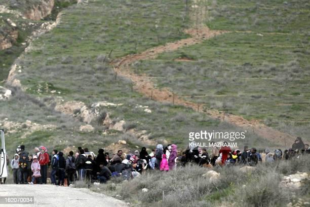 Syrian refugees cross the border from Syria into Jordan near Mafraq on February 18 2013 Jordan says it is hosting around 350 Syrian refugees...
