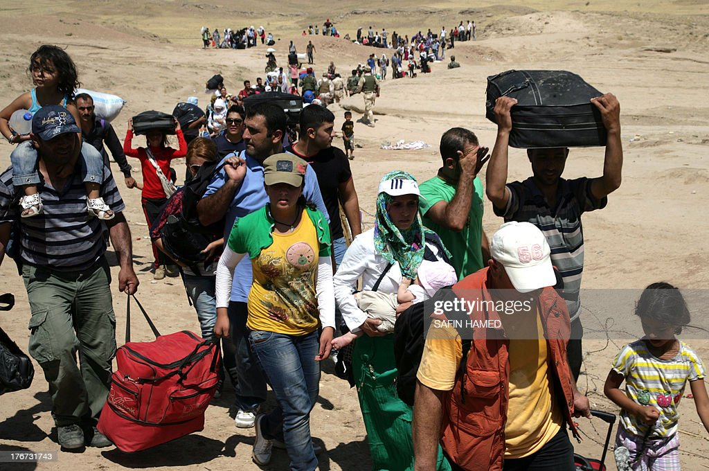 Syrian refugees cross the border into the autonomous Kurdish region of northern Iraq on August 17 2013 Faced with brutal violence and soaring prices...