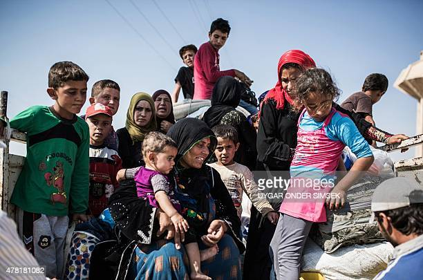 Syrian refugees cross the SyriaTurkey border on June 22 as they return to the northern Syrian town of Tal Abyad in Syria's Raqqa governorate after...