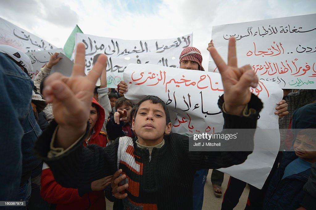 ZA'ATARI JORDAN JANUARY 30 Syrian refugees demonstrate against the Assad regiem inside the Za'atari refugee camp on January 30 2013 in Mafrq Jordan...