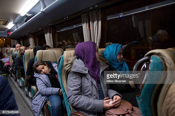 Syrian refugees Doha Asaaid Alkhateb Sham Asaaid Alkhateb and Fatima Asaaid Alkhateb sit in a bus in early morning hours on their way to take a...