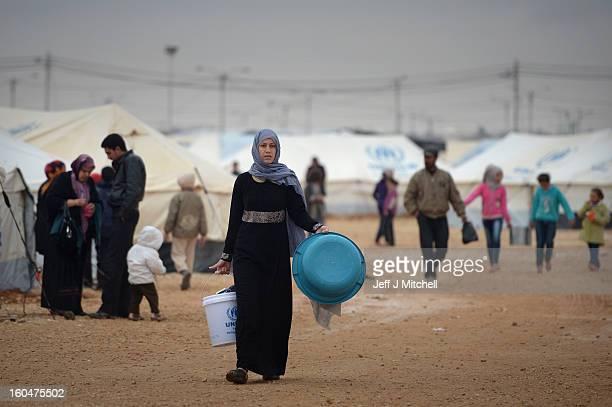 ZA'ATARI JORDAN FEBRUARY 01 Syrian refugees fetch water in the Za'atari refugee camp on February 1 2013 in Za'atari Jordan Record numbers of refugees...