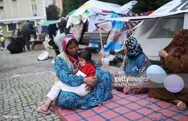 Syrian refugees go on their daily life in a park on November 3 in Istanbul According to the Turkish Disaster Management Authority the number of...