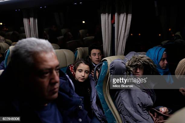 Syrian refugees Hassan Asaaid Alkhateb and his children Doha 16 Sham Fatima and Mohamed sit in a bus in early morning hours on their way to take a...