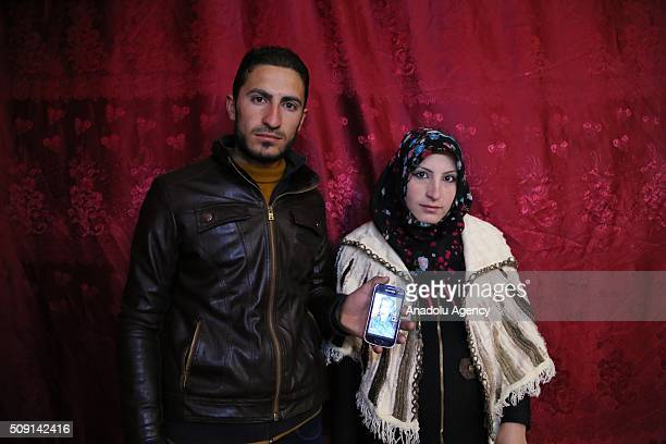 Syrian refugees Housem Suleyman and his wife Busra Omar fled 45 years ago from Syria's Hama due to ongoing civilwar pose with Housem's father's...