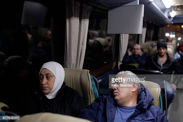 Syrian refugees Lama and Hassan Asaaid Alkhateb sit in a bus in early morning hours on their way to take a special charter flight for Finland on...