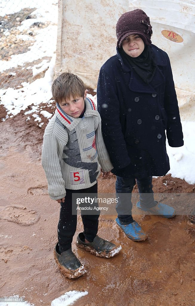 Syrian refugees living in a camp near Esselame Border Gate struggle to survive in harsh winter conditions in the Syrian town of Azaz, on the outskirts of Aleppo on December 14, 2013.