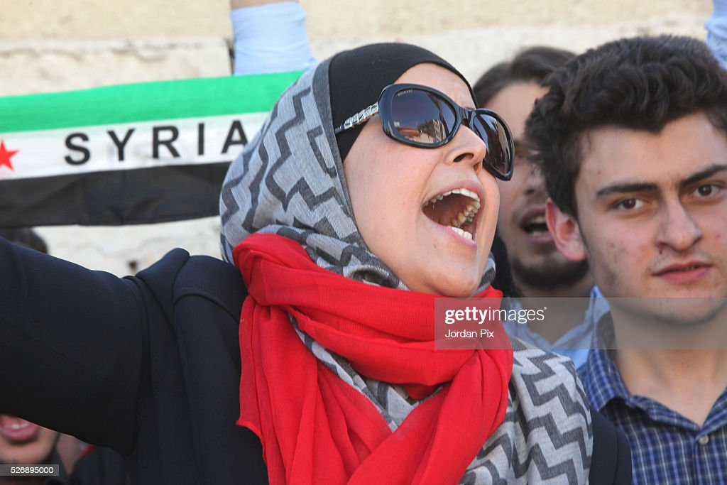 Syrian refugees living in Jordan protest against the world silence towards the air strikes over the northern Syrian city Aleppo during a sit-in protest in front of the UN Headquarters on May 1, 2016 in Amman, Jordan. According to news reports, many civilians have been killed as a result of airstrikes.