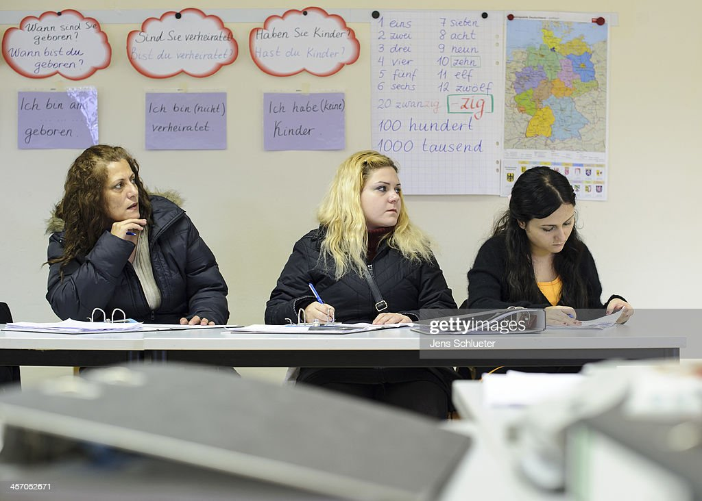 Syrian refugees Nada Alkaaki (L-R) and her daughters Khouloud Alhraki and Alia Alhraki participate in a German language class at the refugee center on December 10, 2013 in Friedland, Germany. They fled their native Aleppo via Damascus and Beirut (lebanon) following fighting between rebels and government forces that devastated the city. Nada Alkaaki says: 'I'm happy to be in Germany and I want that my daughters can study here'. Hundreds of thousands of Syrians have fled Syria to neighboring countries as well as to Europe. Germany is accepting up to 5,000 Syrian refugees, though German church leaders recently called on their country to take at least 10,000.
