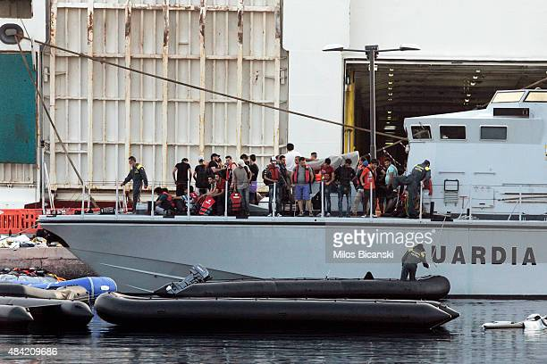 Syrian refugees on Frontex patrol boat while they are excorting them to be board ship 'Eleftherios Venizelos' at Kos's main port on August 16 2015 in...