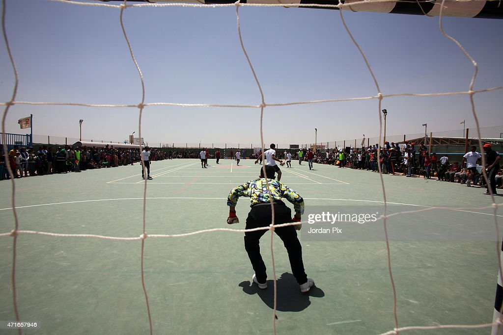 Syrian refugees play soccer in the Al-Azraq camp for Syrian refugees on April 30, 2015 in Al-Azraq, Jordan. To celebrate the first anniversary of the camp's opening, UNHCR, Care and other partners innaugurated a multi-purpose sports ground, a souk in the market in Village 3, launced the 1st Azraq soccer cup, an open air cinema and other recreational activities for children and adults. The camp is located in the desert 110 km to the east of Amman and not far from the Syrian border