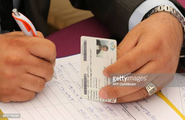 Syrian refugees register their names at the Zaatari office for employment on October 4 2017 in the refugee camp 80 kilometres north of the Jordanian...